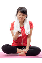 Wall Mural - Woman listening to music in exercise outfit