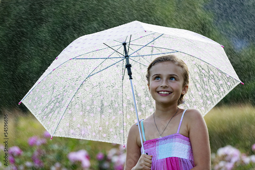 Wall Mural - Summer rain - happy girl with umbrella in the rain