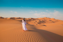 Wall Mural - UAE. Woman in desert
