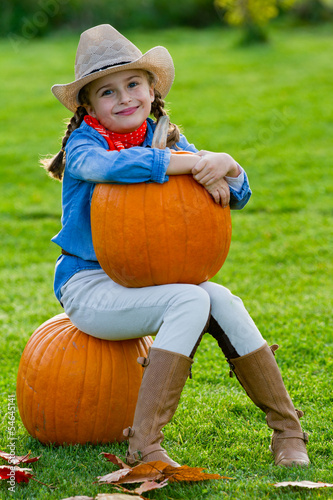 Wall Mural - Harvest of pumpkins, lovely girl and large pumpkins
