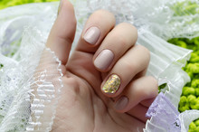 Wall Mural - Beautiful female hand with beige nail design.