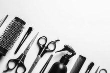 Wall Mural - Composition with scissors and other hairdresser's accessories on white background, top view
