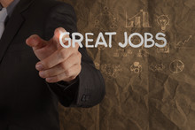 Wall Mural - businessman hand draws great jobs words on crumpled recycle pape