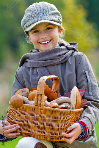 Wall Mural - Season for mushrooms - girl with basket of picked mushrooms