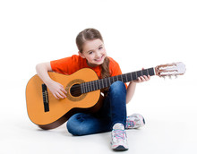 Wall Mural - Cute girl plays on the acoustic guitar.