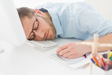 Wall Mural - Young designer sleeping at his desk