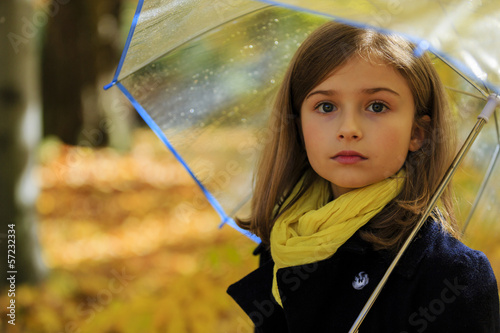 Wall mural Autumn rain - beautiful girl with an umbrella in park