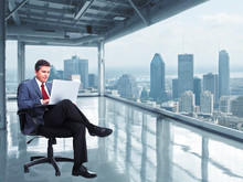 Wall Mural - Businessman with laptop computer in the office.