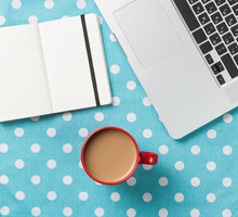 Wall Mural - Cup and notebook near laptop comuter