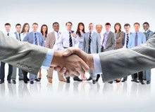 Wall Mural - handshake isolated on business background