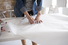 Wall Mural - Women are making the clothes of the pattern in the studio
