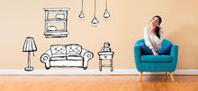 Wall Mural - New apartment dream with woman in a thoughtful pose in a chair