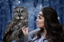 Wall Mural - Fairytale image of a girl and an owl in the winter forest