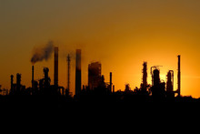 Wall Mural - silhouette of ibig oil refinery factory  during sunset