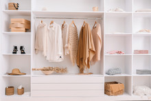 Wall Mural - Wardrobe with stylish female clothes