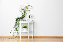 Wall Mural - Dressing table with green houseplants near white wall