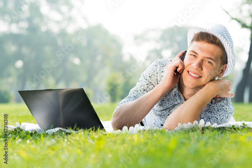 Wall Mural - young man with a cell phone