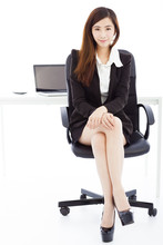 Wall Mural - young confident business woman sitting in her office
