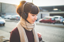 Wall Mural - young beautiful hipster woman listening music