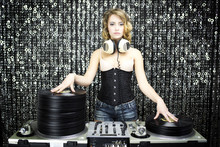 Wall Mural - beautiful female dj with pile of vinyl